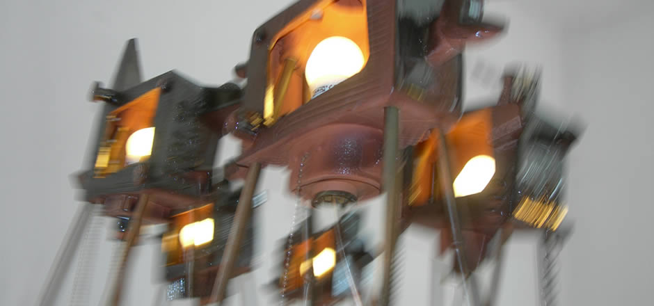 War of the Worlds, a ceramic tableau of terra cotta TV sets illuminated with light bulbs, complete installation is about 1m high by 2 metres wide.