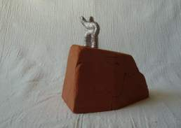 New wave, aluminium figure on a terra-cotta base. Approx 10cm high overall