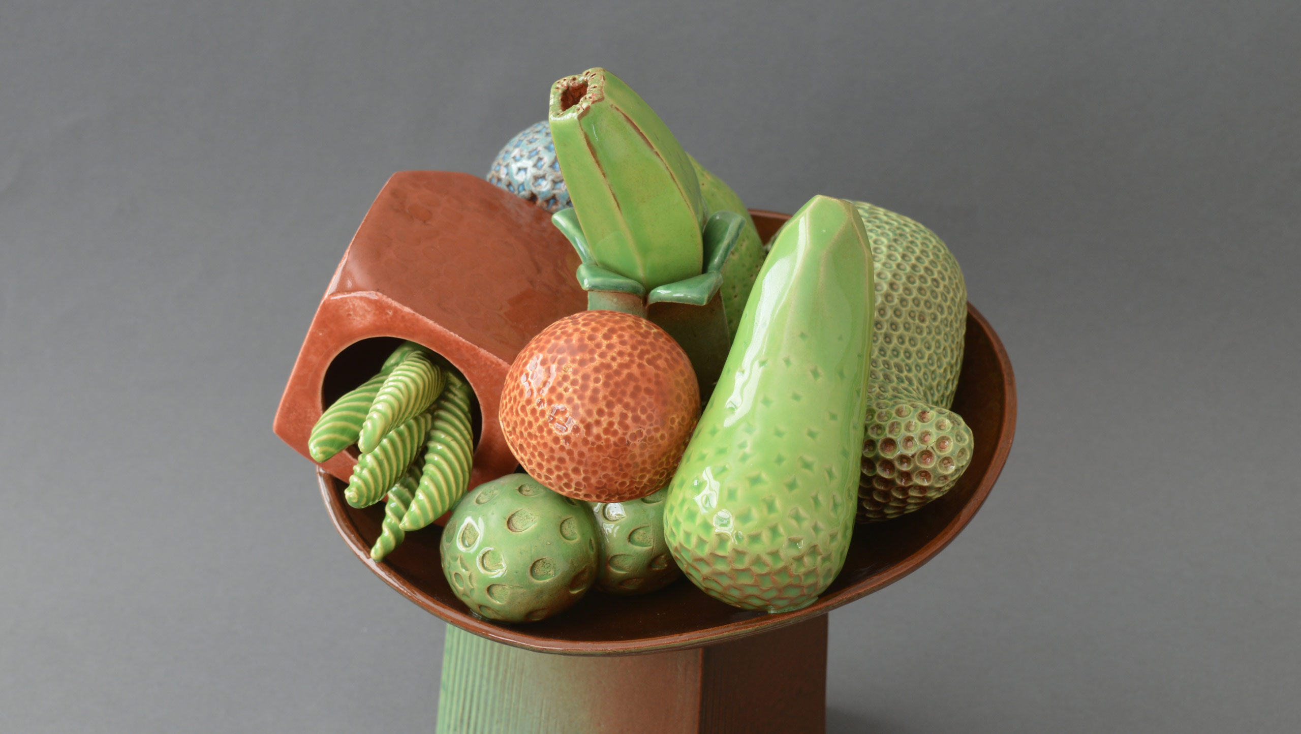 Photograph of 'Abundance' - A still life on stand by contemporary ceramic artist Simon Fell