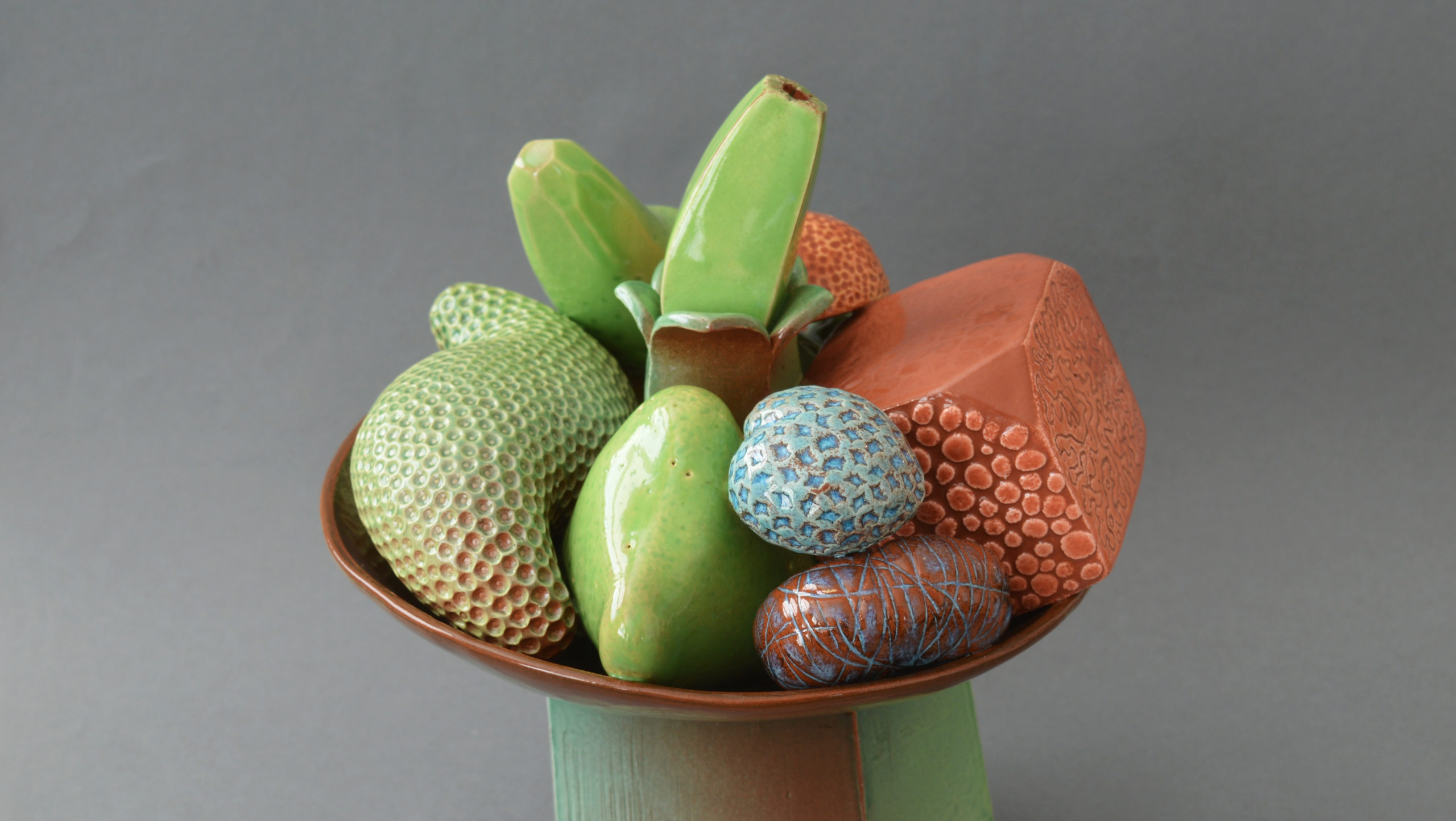 Photograph of 'Abundance' - still life on stand by contemporary ceramic artist Simon Fell