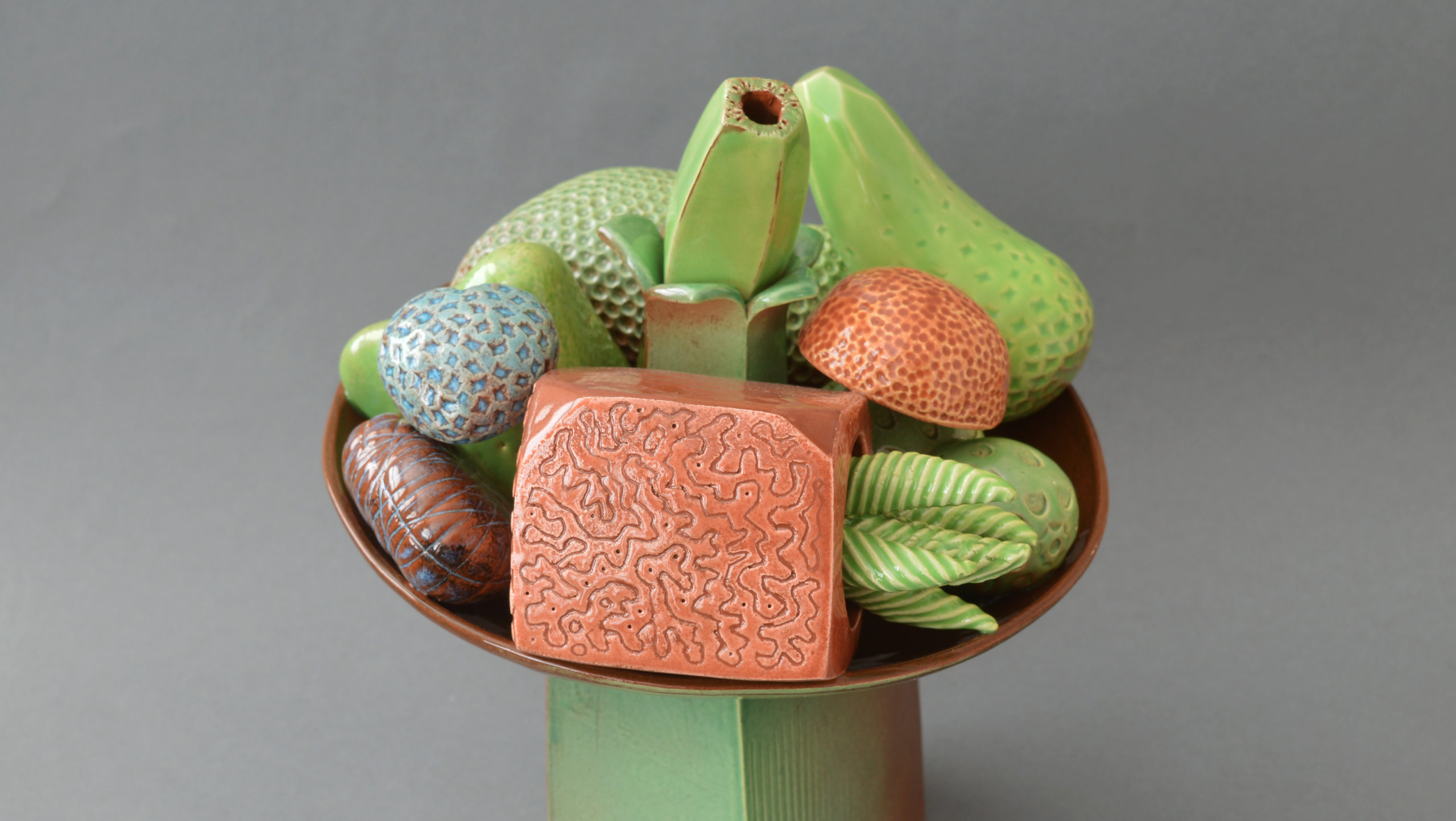 Photo of 'Abundance' - A still life on a stand by contemporary ceramic artist Simon Fell
