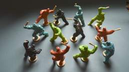 Riot of colour - twelve small coloured figures with clubs