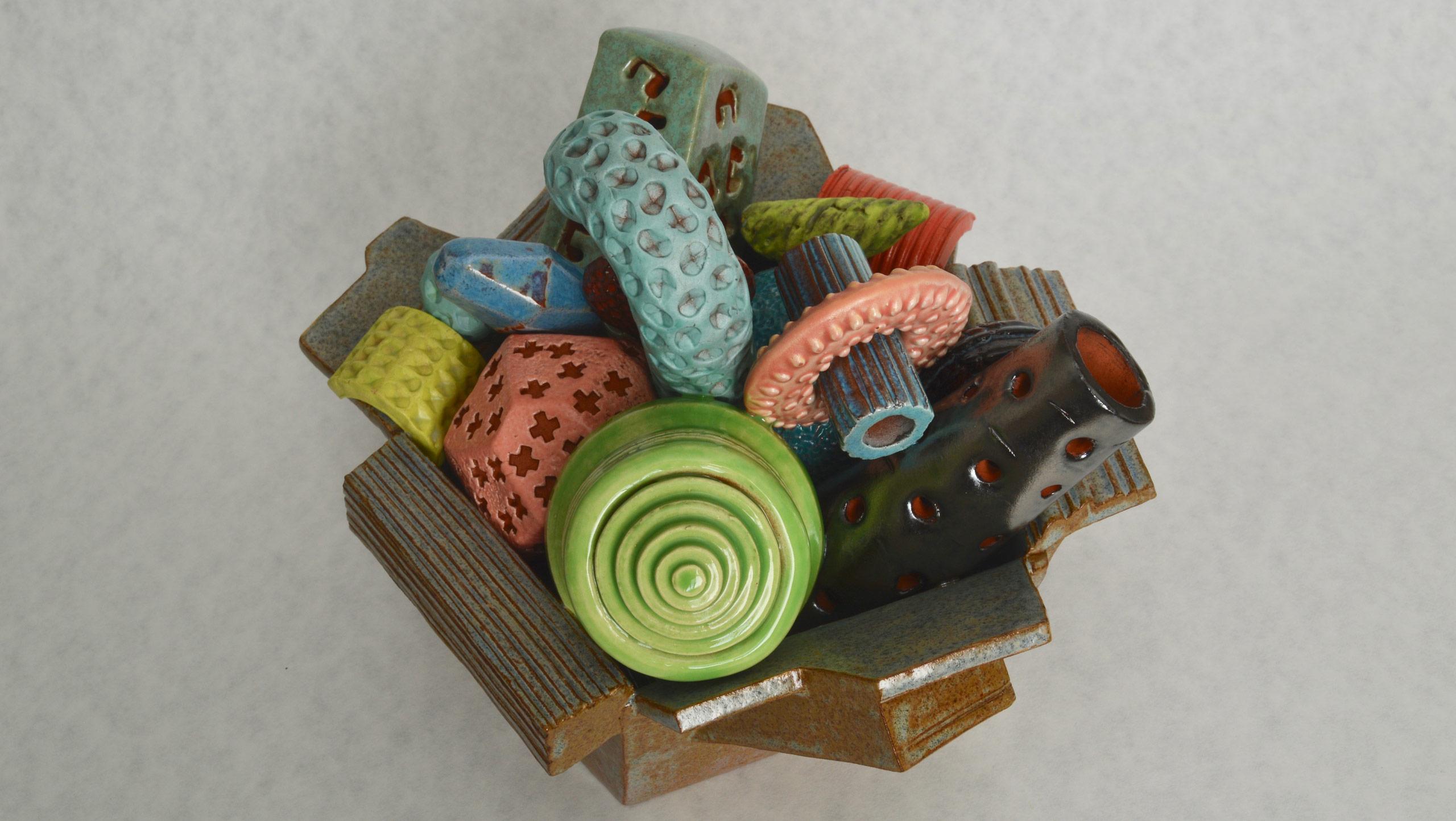 Ship o' Ferrules, a ceramic still-life in glazed earthenware by sculptor Simon Fell