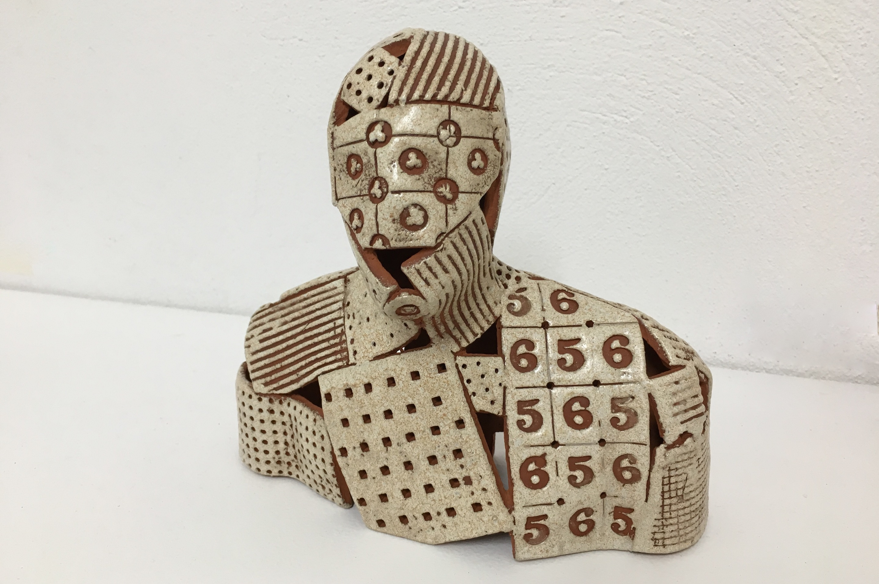 Glazed terracotta figure. One of the elements from 'Enlightenment', an evolving project installation in mixed media