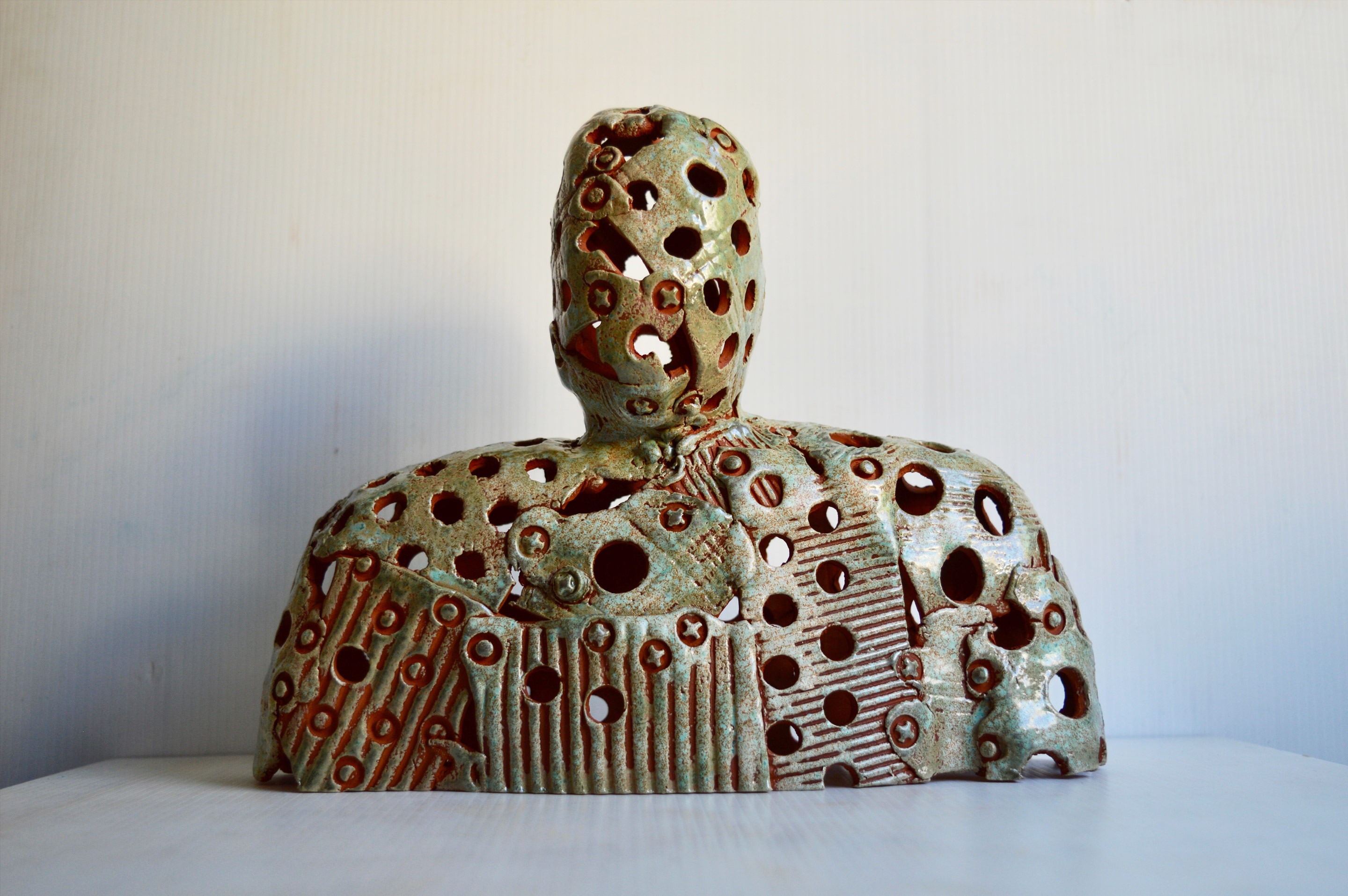 A glazed teracotta figure. One of the figures from 'Enlightenment', a rolling project installation in mixed media