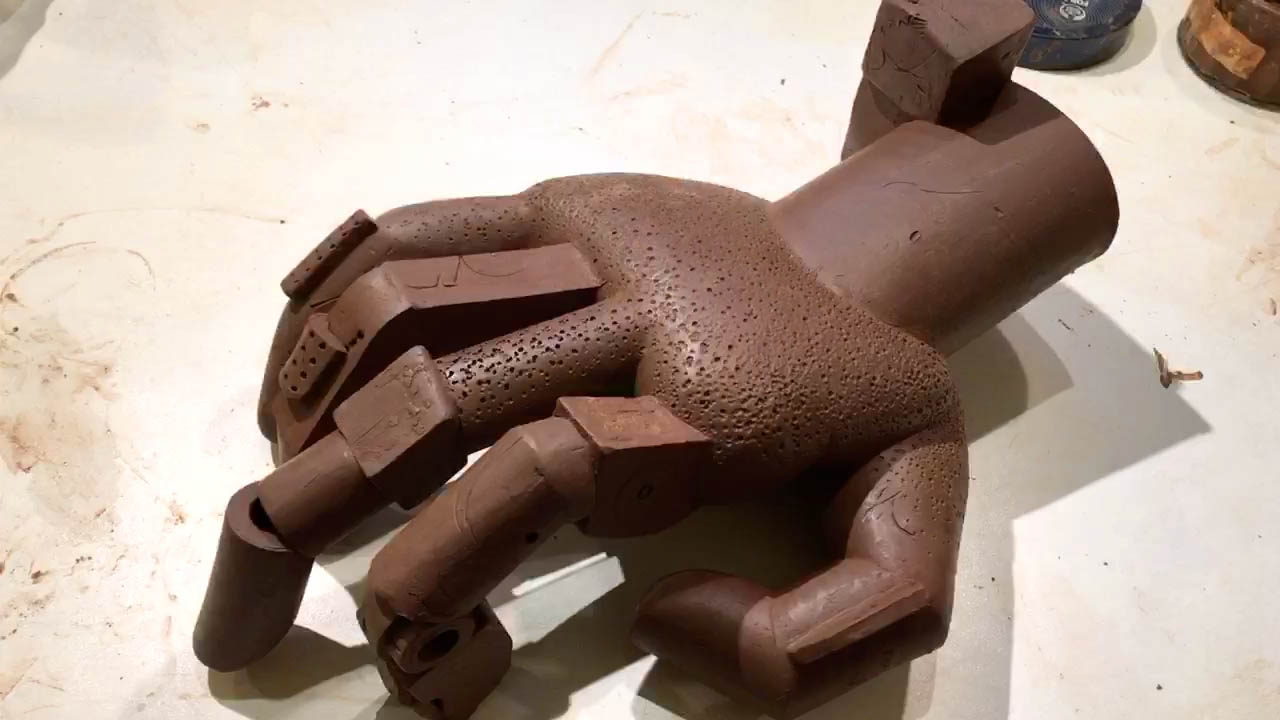 Clay hand sculpture by Simon Fell in the leather hard state