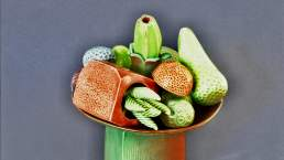 Image of 'Abundance' - A still life on stand by contemporary ceramic artist Simon Fell
