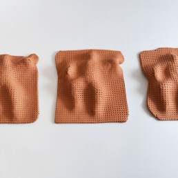 Blanketed - three terracotta modelled ceramic sculptures by Simon Fell