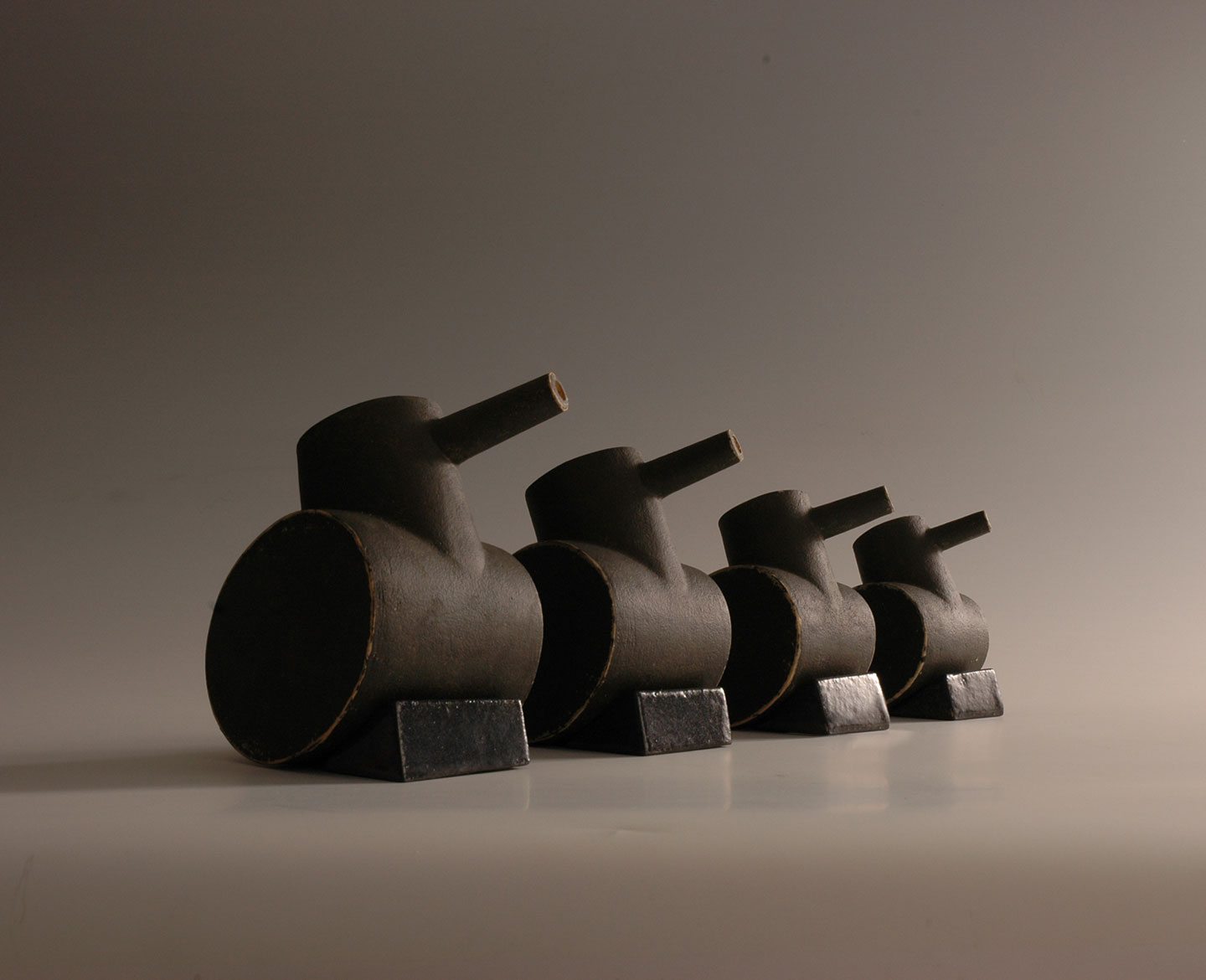 Tank family, stoneware ceramic sculpture, height 15cm max